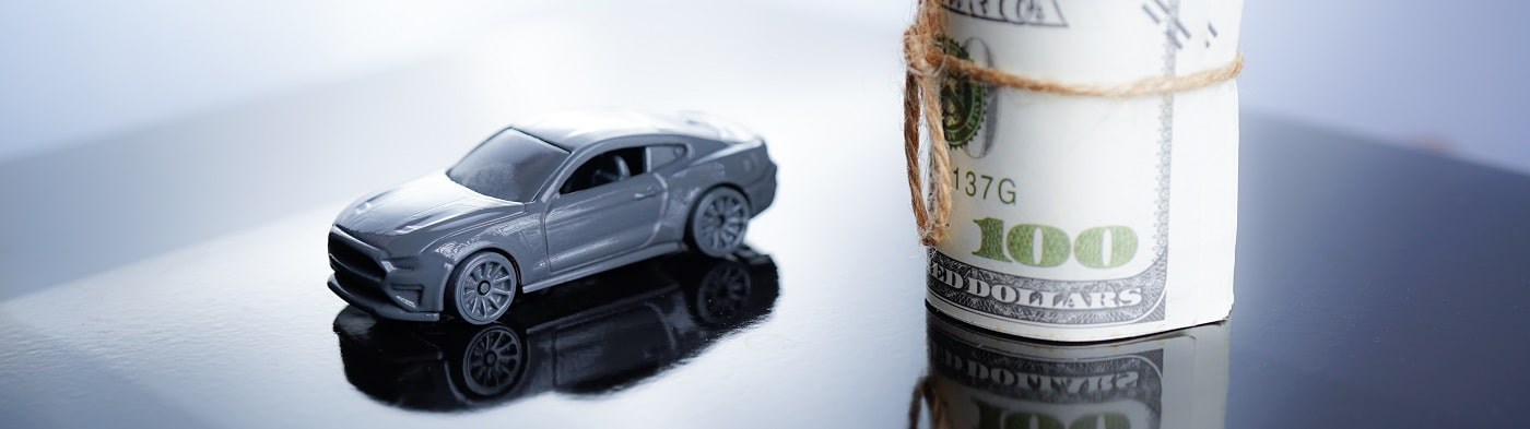 Bad Credit Financing - model car with roll of cash